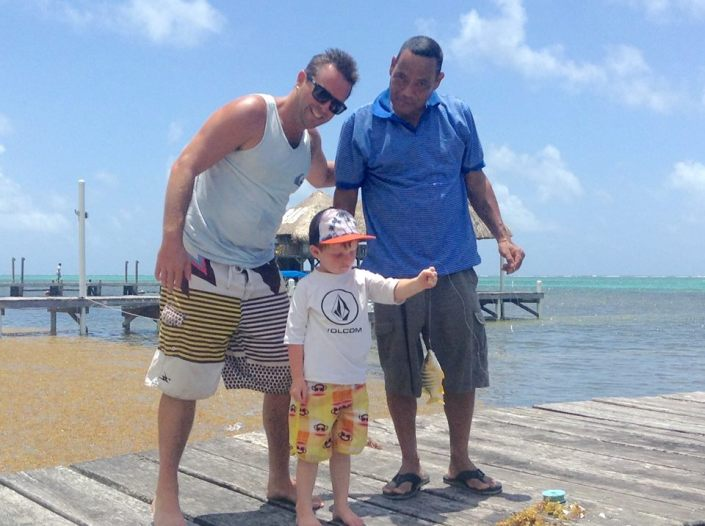 Castillo (right) helped Brody catch his first fish off a dock with a hand line. The beaming dad on the left is Brendan, my oldest son.