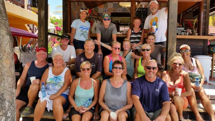 After two hours picking up trash in the broiling sun, why is this group smiling? Island love, for sure as well as iced coffee and cookies from Marbucks and chilled and scented washcloths from Pilates by Rose sure help.