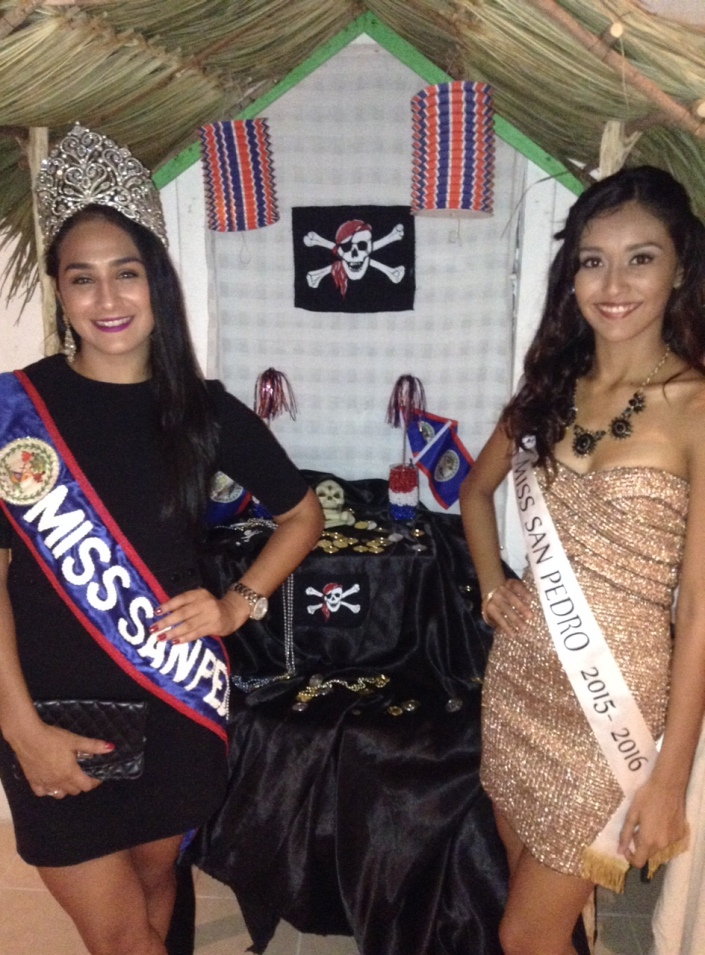 Even comely maidens succumb to the lure of pirate's gold .... Miss San Pedro elect Iris Salguero (right) and her lovely successor Michelle Estrella Nunez attended the opening of Pirates of Belize exhibit at the San Pedro House of Culture.