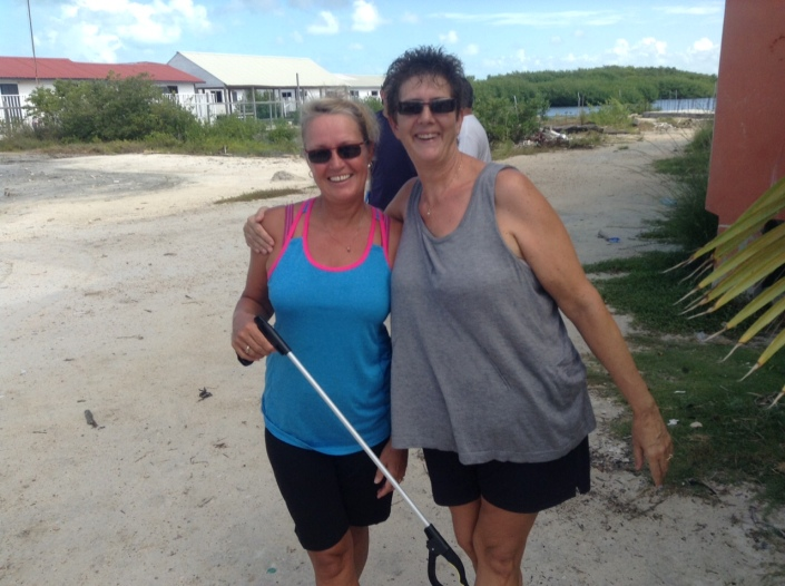Linda Rumney shows off her new trash picking stick with Susan Barkhouse.