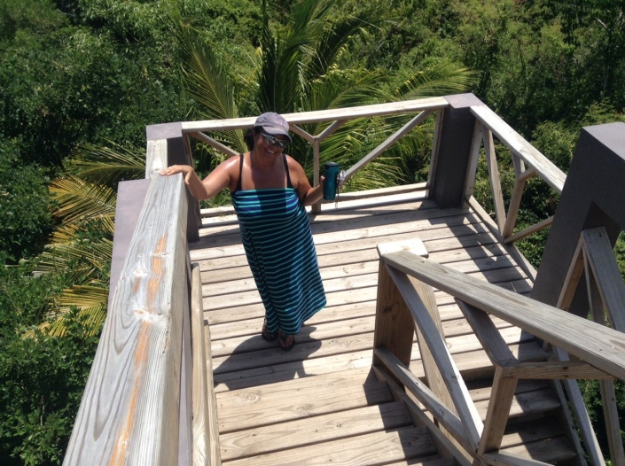 Carmen Arenal strikes a pose as she nearly reaches the top of the observation tower at Bacalar Chico Ranger Headquarters.