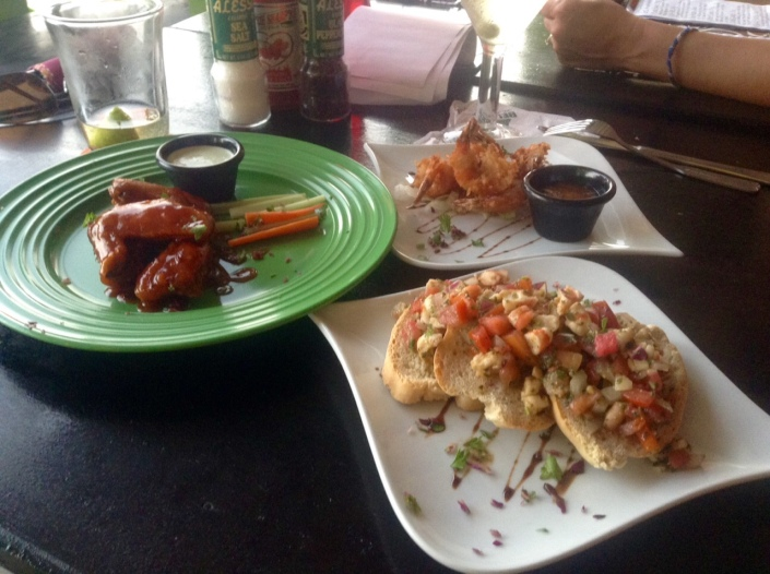 A sampling of the appetizers we enjoyed at Nook -- chicken wings, coconut shrimp and  brochette. All quite tasty.