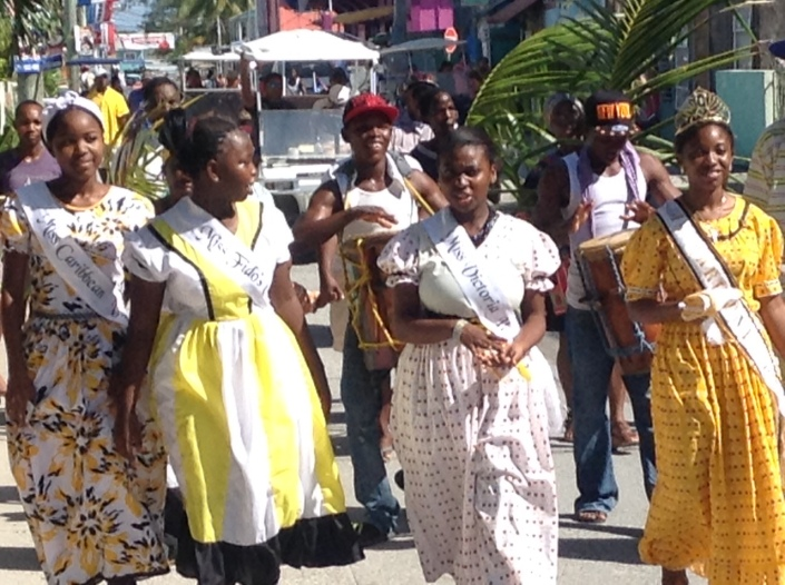 On Back Street: A ceremonial procession from Central Park to the municipal football field marks the beginning of Thursday's crowning of a new Miss Garifuna San Pedro ambassador. Three of the contestants and the outgoing Miss Garifuna lead a procession of drummers and palm-bearing followers.