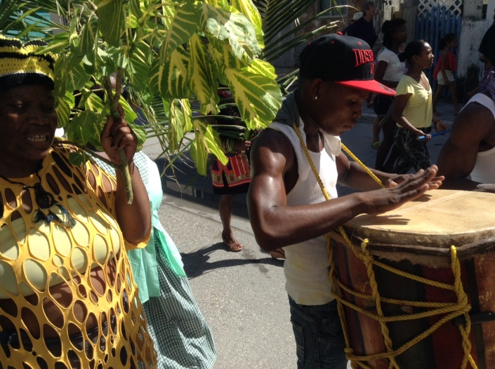 A ceremonial procession from Central Park to the municipal football field marks the beginning of Thursday's crowning of a new Miss Garifuna San Pedro ambassador. Three of the contestants and the outgoing Miss Garifuna lead a procession of drummers and palm-bearing followers.