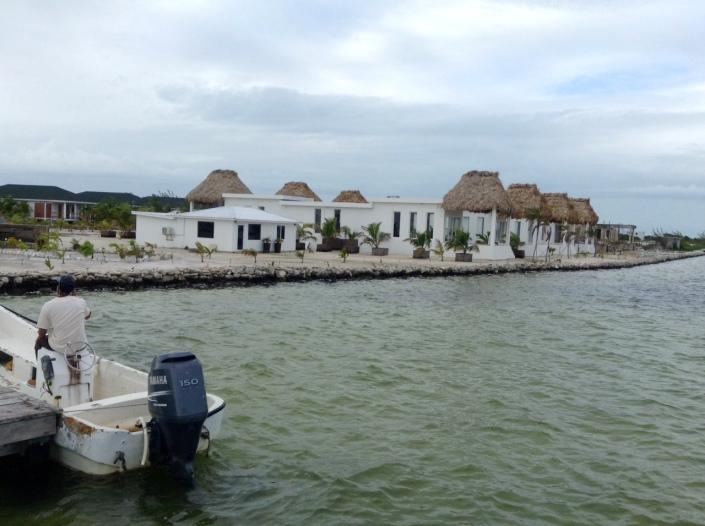 Shotgun-style, one-bedroom cabanas that face back toward San Pedro.