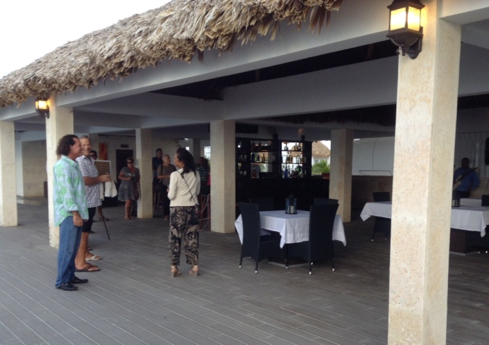 FounderCEO Scott Zeus Smith (in blue-green shirt) chats with guests at Mayan Islands Resort.