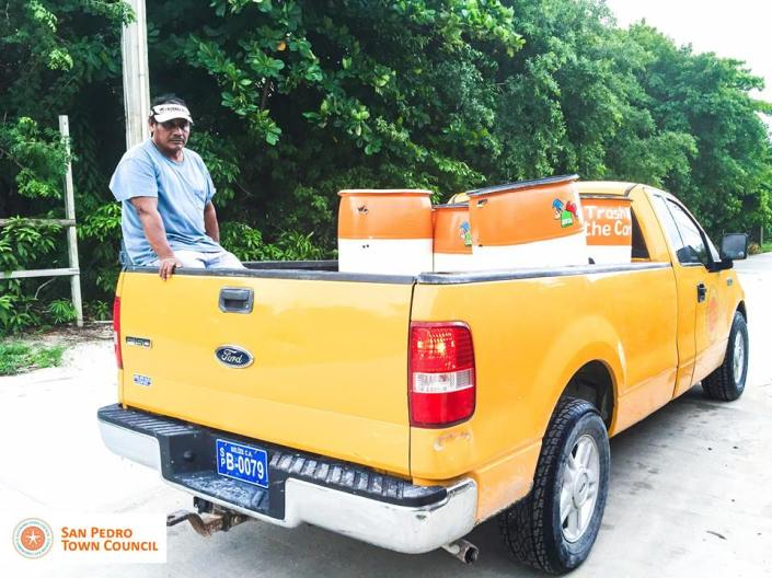 San Pedro town crew distributes new trash barrels north of the bridge on Ambergris Caye. (Photo courtesy SP Town Council)