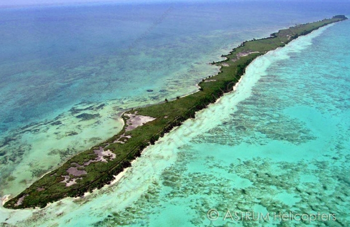 An aerial view of Blackadore Caye where Leonardo DiCaprio and investors hope to build the greenest eco-resort in all of Belize, while saving the rest of the island from self-destruction.