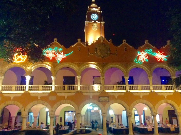 A government building on Merida's Grand Plaza. It is situated directly opposite a cathedral -- and don't you think that is freighted with symbolism? Merida is magical at night, lights, music and art are everywhere.