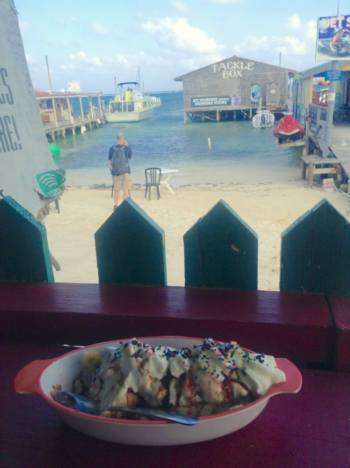 Happiness is discovering that Latitudes Cafe has one hell of a banana split while waiting for a water pump to arrive on the water taxi from Belize City.