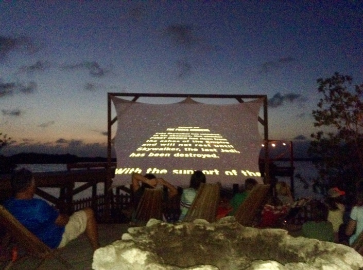 "Lights, camera, roll 'em! The sun sets and ""Star Wars: The Force Awakens"" begins at the Truck Stop, San Pedro, Belize."