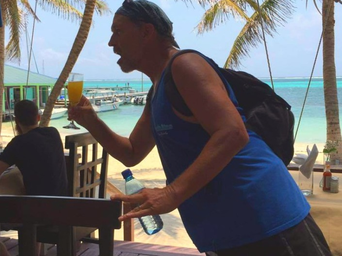 Hydration is so important when you are walking a 5K in tropical weather. Fortunately our friends at the Holiday Hotel were willing to share their mimosa with me as we passed by. (Photo by Ruth Rinehart.)