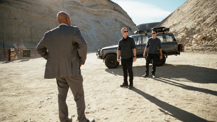 "Here's the proof! FBI agents on Ambergris Caye are dwarfed by the barren hillsides of the island in a scene from the ""Criminal Minds: Beyond Borders"" episode ""Love Interrupted."""
