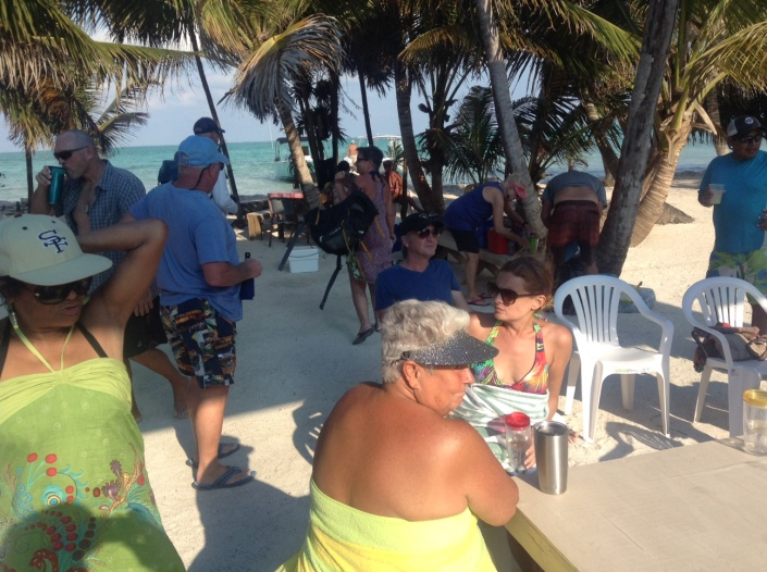 The gang gathers for food and conviviality around the picnic tables on Blackadore Caye.