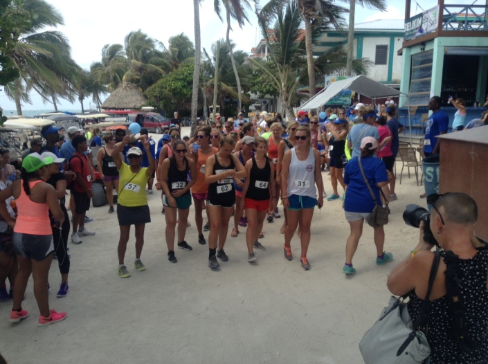 Some of the runners and walkers begin to mingle around the starting line for Sunday morning's Autism Awareness 5K in San Pedro, Belize.