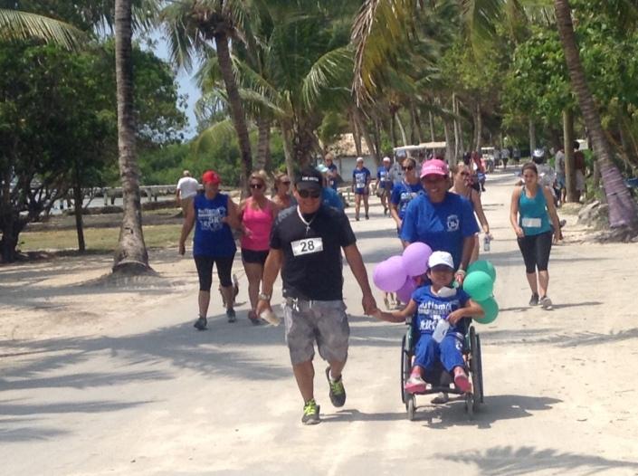 Wayo walks with VIPs in the Autism Awareness 5K run/walk on Boco del Rio in San Pedro.