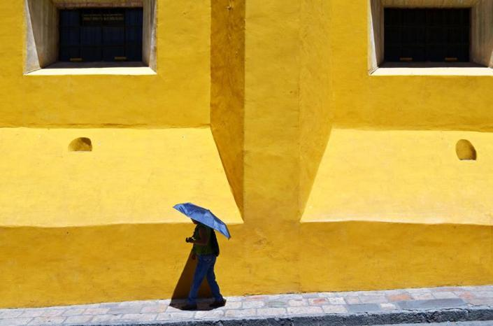 "This is an example of the photographic artistry of my friend and colleague Jerry Rife, who lives much of the year in San Miguel de Allende, Mexico. Yes, this is a photograph. Jerry has learned to retrain his ""news"" eyes. Now he sees life on the streets, beauty, drama, textures, people as things unto themselves. He now photographs truth, not news."