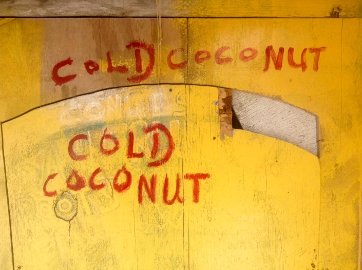 """As long as there are crudely drawn and artfully painted signs for commerce on Caye Caulker there is hope that """"Go slow"""" will remain a way of life and not an urgent plea."""