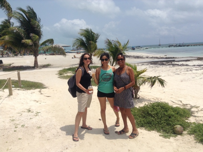"Rose (at right) with her cousin Coco (left) and friend Paty (center) on the beach in Caye Caulker. They are fr""from Philly way"" (as they wrote on the wall at the Palapa Bar and Grill in San Pedro after we returned from our day trip to Caye Caulker."