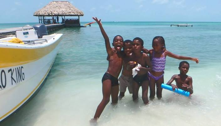 Kids who live on Caye Caulker just always seem to be having a good time. Met up with this bunch on a visit to the island on Sunday.