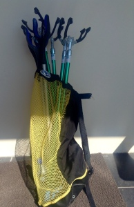 My diving gear bag has temporarily become a caddy for pickup trash sticks. Have sticks, will travel ......
