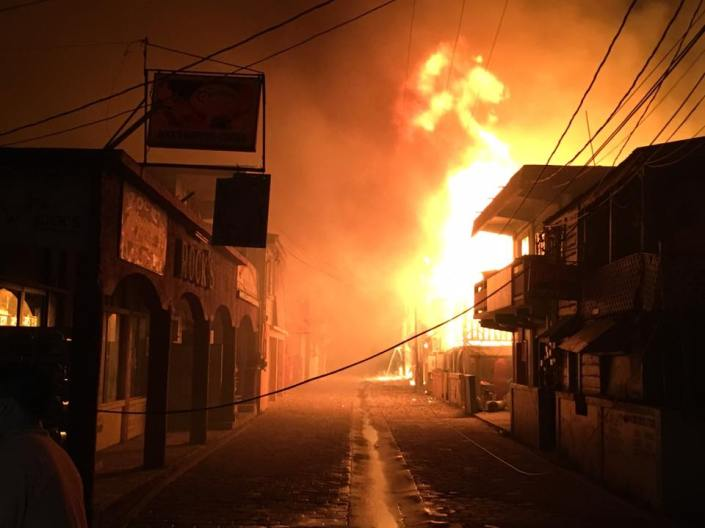 The fire along the eastern side of Middle Street, San Pedro early this morning. (Photo by Jorge Aldana)