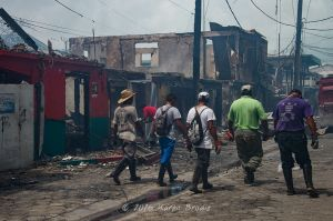 Work crews beginning the large debris cleanup as remanants of the fire continued to smolder. (Photo by Karen Brody)