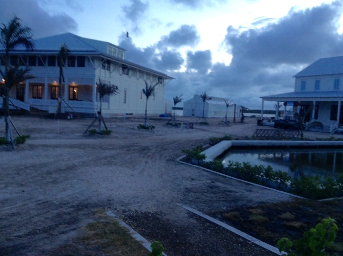 """A glimpse of the 22,000 square-foot """"Great House"""" at Mahogany Bay Village, toward sunset."""
