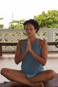 Tara in a peaceful moment during yoga class at Zen Belize in San Pedro Town, Ambergris Caye, Belize.