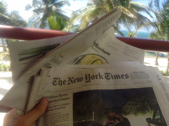 A man in his element -- on the deck with a cup of coffee and a fresh copy of The Sunday New York Times. Life is good.