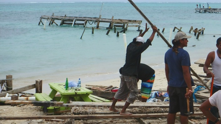 This scene is repeated all up and down the sea coast of Ambergris Caye. Ripping dock remnants, stacking boards.