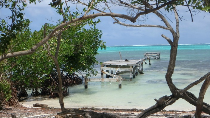 This was once my favorite pier in all of Ambergris Caye. It was beaten up long ago but was framed in mangrove and had a white lattice gate that gave it a mystical aura, like it was a port to another world. No more.