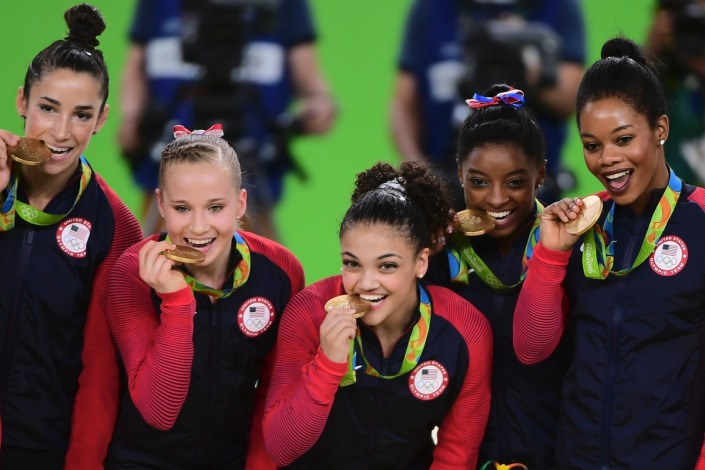 Aly Raisman, Simone Biles, Laurie Hernandez, Madison Kocian and members of 2012's team and Gabby Douglas