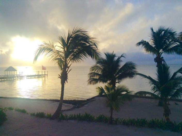 "Good morning from Ambergris Caye, Belize. If there wasn't a hurricane bearing down on us, I'd say what a glorious Caribbean morning we have. So calm, the sea is so flat, the air is so still, the humidity hangs on us like a soggy old jacket. The sun spins a soft dewy golden gauze through clouds surprisingly whispy, for an approaching hurricane. Earl is on the horizon but this morning the hummingbirds go about their business as if nothing is amiss. We take greater precautions because we are more fragile. We wait and wait and try to think of the one thing we have not yet done that will ensure our safety. And wonder if it is not prayer. And yet it is almost embarrassing to say ""Dear God, deliver us from Earl."" Who comes up with these names anyway? — at Ambergris Caye, San Pedro, Belize."