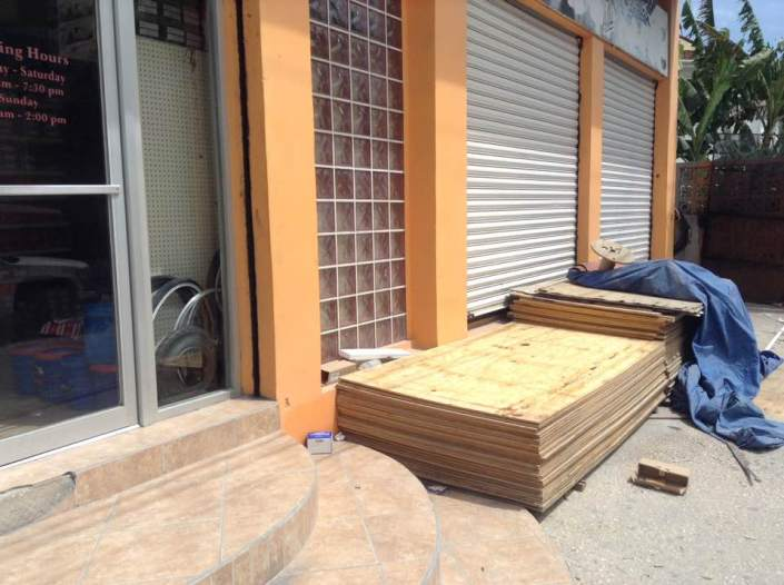 Hot shopping item today in San Pedro. Almost every hardware store has plywood out front. Inside batteries and flashlights are selling like crazy. Some folks were gathered around the portable generators at Costillo's looking ready to buy. At Caye Supply, plastic containers of all sizes are selling. Food stores are all busy but we didn't see any frenzied shopping. All the places I went into at mid-morning, to pay bills and do banking, were almost completely empty. Finally, a slight breeze is picking up, sending dust everywhere but the storm is coming. You can feel it advancing like the Dark Army from the east, building pressure as it marches inexorably in our direction. What kind, how powerful and how damaging is still to be seen. — at Ambergris Caye, San Pedro, Belize.
