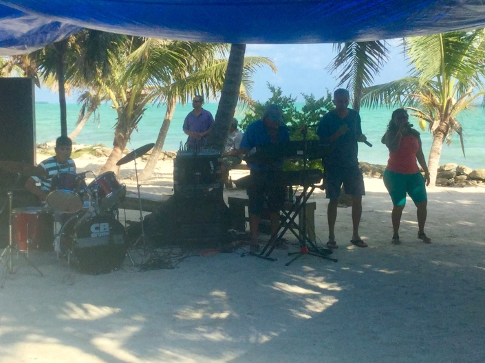 Rompe Raja Band plays for the crowd at Blackadore Caye, Belize.