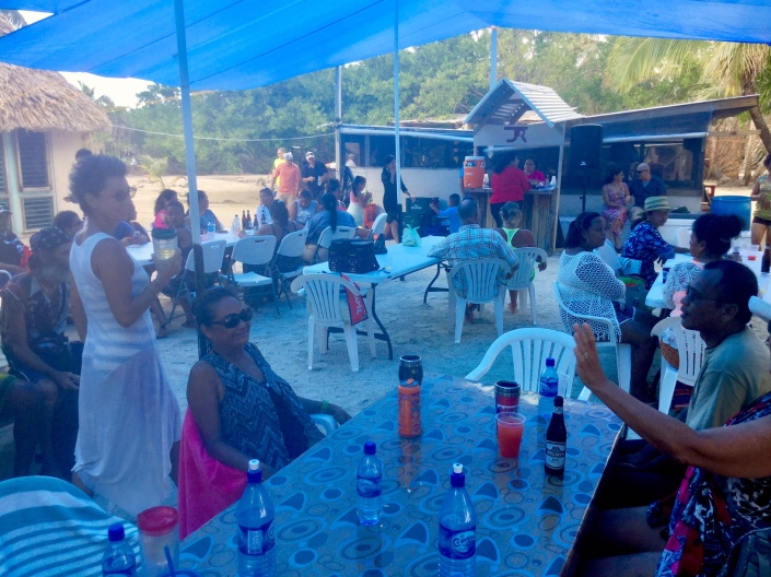 Party goers gather at the Blackadore Caye base, awaiting the arrival of the pibil and venison.