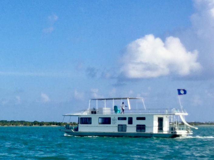 On the way back to Ambergris Caye we passed by the latest water craft of Seaduced by Belize, a party boat called SEA's d Day. The crew was making practice runs on the back of the island. Looks like fun!