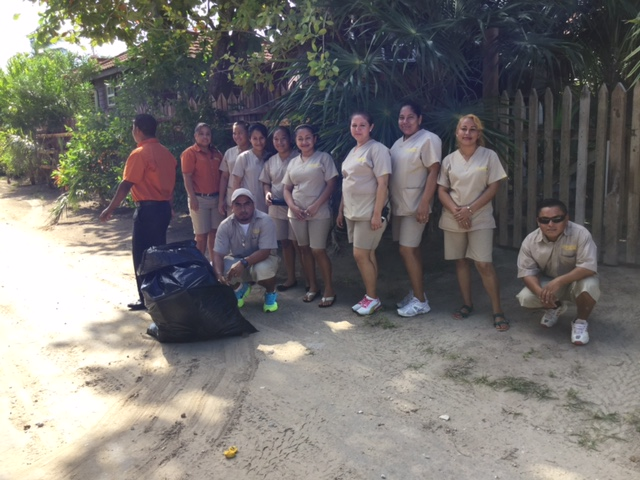 Staff from Grand Caribe arrive fresh off the beach-side cleanup.