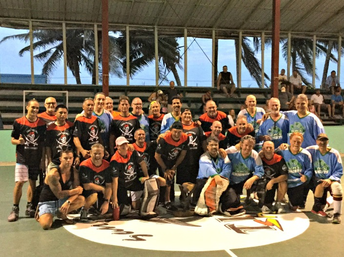 """San Pedro Buccaneers and Withrow Park (Toronto) Tropical Knights  come together for a group shot at the end of the tournament. Two things that I heard and liked a lot: """"Wait until next year!"""" and """"We'll bring more teams!"""""""