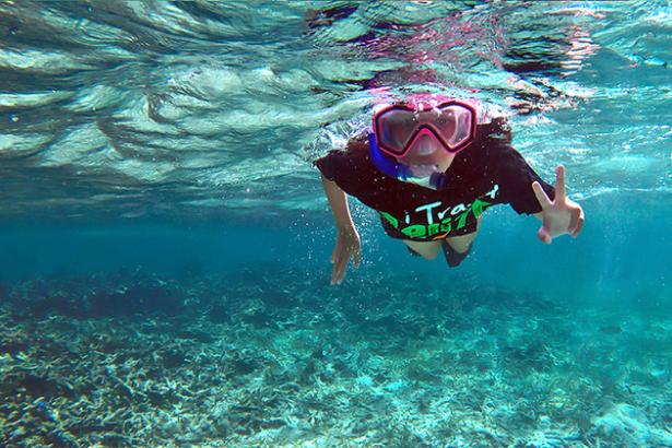 Madison Pearl Edwards is snorkeling the 190-mile Belize barrier reef to highlight the dangers of oil exploration to the country's greatest natural resource. She is 11 years old. (Photo courtesy of amergristoday.com
