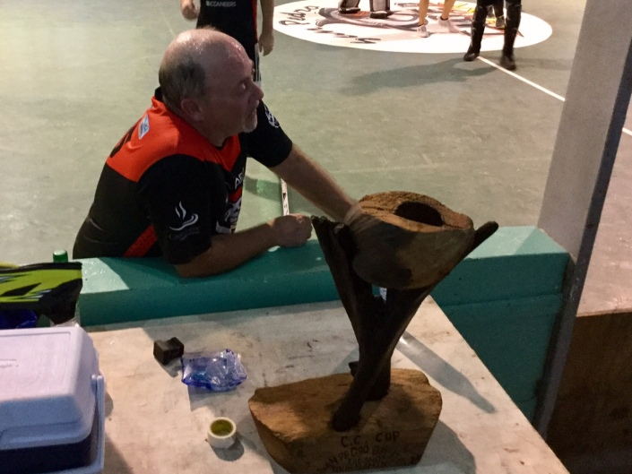 An exhausted Paul DuVille catches his breath beside the coveted Coconut Cup at the end of the final game. Everybody left it on the field on this day.